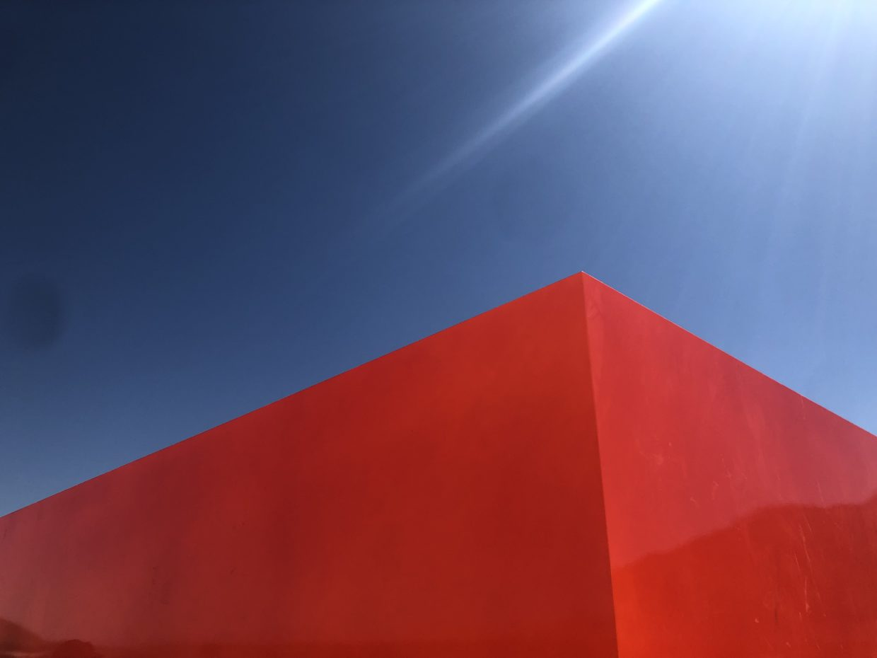 a red box against a blue sky